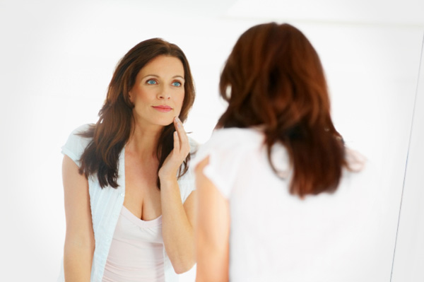 woman-in-forties-looking-in-mirror